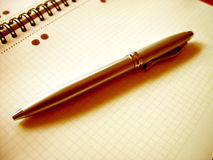 BUSINESS PEN ON A NOTE-BOOK Stock Images