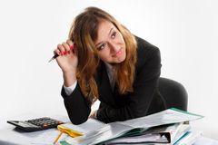 Business, pen, women. Business woman thinking hard, touching fountain pen to the head Royalty Free Stock Photography