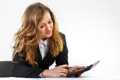 Business, pen, women. Woman thinks on the calculator Stock Photography