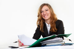 Business, pen, women. Woman thinks on the calculator Royalty Free Stock Images