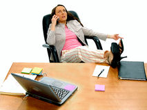 Business People 1. Casual female Executive kicked back at her desk talking on cell phone stock images