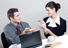 Business people. Bussinessman and businesswoman working at office Stock Images