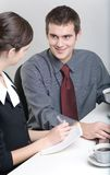 Business people. Bussinessman and businesswoman working at office Stock Image