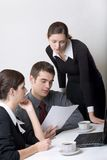 Business people. Bussinessman and two businesswomen working at office Royalty Free Stock Photos