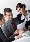 Business people. Bussinessman and two businesswomen working at office Royalty Free Stock Image
