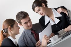Business people. Bussinessman and two businesswomen working at office Stock Photography