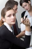 Business people. Bussinessman and two businesswomen working at office Stock Photo