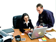 Business People 17. Businessman and businesswoman making a credit card purchase online royalty free stock photo