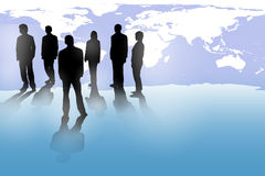 Business people. Standing with world map Stock Photography
