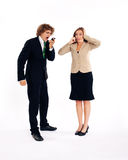 Business people. Both are on their mobile phone, he is shouting in his cell phone Stock Photography