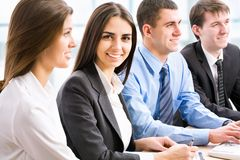 Business people. Image of a beautiful business women and her colleagues in the office stock images