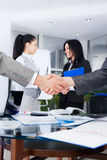 Business people. Business handshake with business people on background, colleagues shaking hands during meeting after signing agreement in office Royalty Free Stock Photography