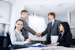 Business people. Handshake during meeting after signing agreement in office, businesswoman at desk smile Stock Photo