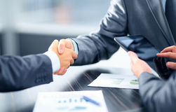 Business people. Shaking hands in office Royalty Free Stock Image