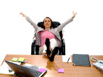 Business People 3. Casual business woman stretching with feet up on desk Stock Image
