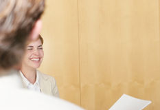 Business people. Two business people standing talking and laughing Stock Images