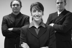 Business People. Three Business People standing together in an office Stock Photo
