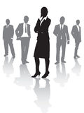 Business people. A smart lady out in front Stock Photography