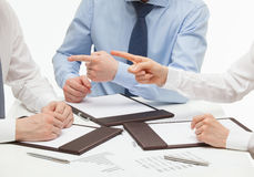 Business people accusing their business partner Stock Images