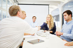 Business people achieve an agreement Stock Photos