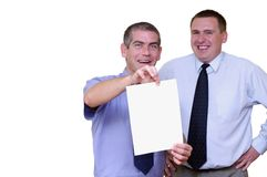 Business people - Add your message. Focused on the man holding a blank white sheet of paper Royalty Free Stock Photo