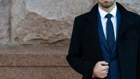 Businessman or ceo urban fashion standing near the wall. Business and success. Man in formal on the street near the office stock image