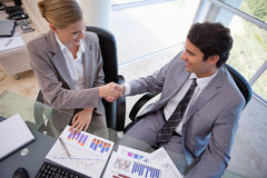 Business people agreeing on a deal stock image