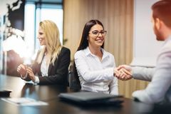 Business people agreement during board meeting. In office Stock Image