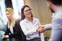 Business people agreement during board meeting Stock Image