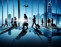 Business People In An Airport. Group of business people in an airport for a business trip Stock Image