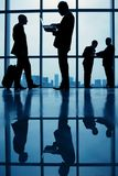 Business people in airport Stock Images