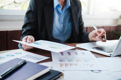 Business people analyse high performance solution. Royalty Free Stock Photo