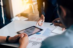 Business people analysis finance reports and working together on stock photo