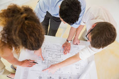 Business people analyzing blueprint Stock Photo