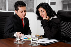 Business people analyzing charts Stock Photos