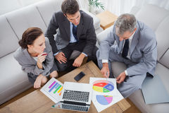Business people analyzing diagrams together Royalty Free Stock Photography
