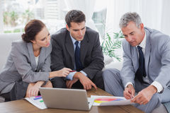 Business people analyzing financial graphs of their company Royalty Free Stock Image