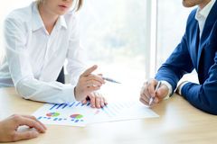 Business People Analyzing Financial Results on Graphs around the Table in Modern Office. Team Work Concept Royalty Free Stock Photo