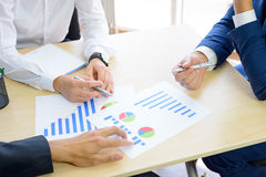 Business People Analyzing Financial Results on Graphs around the Table in Modern Office. Team Work Concept Stock Images