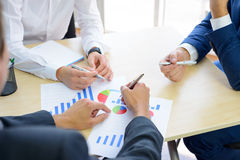 Business People Analyzing Financial Results on Graphs around the Table in Modern Office. Team Work Concept Royalty Free Stock Photos