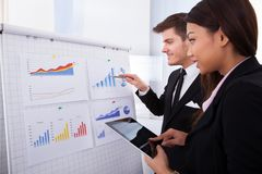 Business people analyzing graph in office Stock Photography