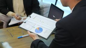 Business People Analyzing Statistics stock video footage