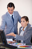 Business people analyzing statistics together Royalty Free Stock Photos