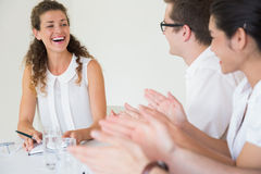Business people applauding for businesswoman Royalty Free Stock Image