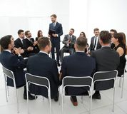 Business people applauding the coach after the lecture . Business concept Stock Images