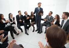 Business people applauding the coach after the lecture . Business concept Stock Photography