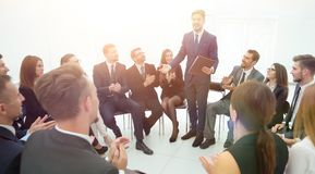 Business people applauding the coach after the lecture . Business concept Stock Photo