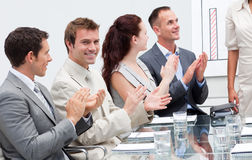 Business people applauding a colleague Stock Image