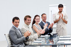 Business people applauding a colleague Royalty Free Stock Image