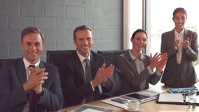 Business people applauding a colleague stock footage